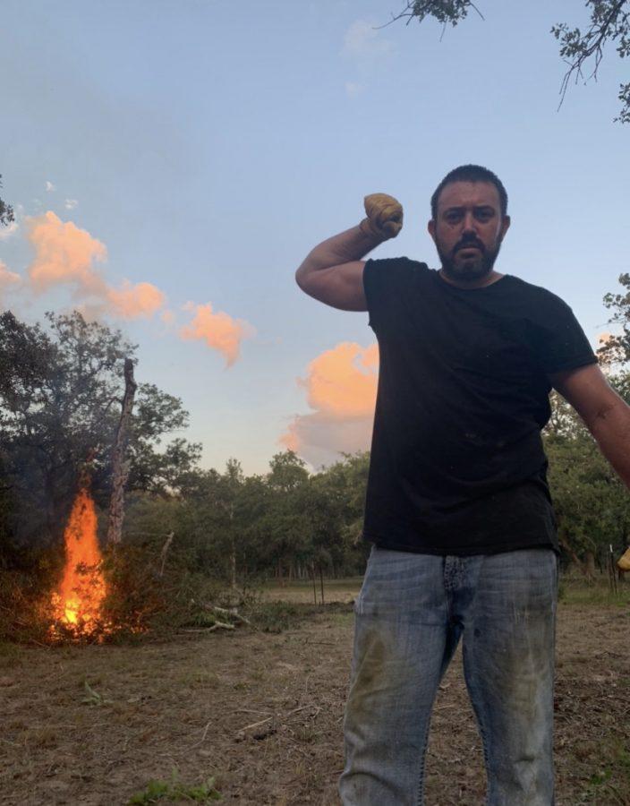 Alexas dad burning underbrush.